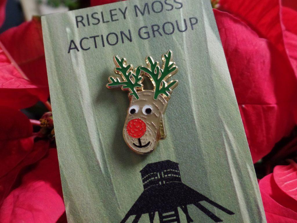 Reindeer pin badge designed o match our handmade wooden reindeer ornaments. Enamel and gold metal plating